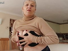 Naughty big breasted British granny playing with herself