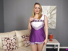 Dressed like randy cheerleader torrid Penny L plays with her boobies