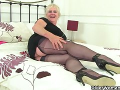 British gilf Zadi fucks will not hear of old fanny with a black dildo