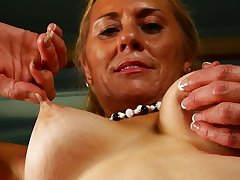Amateur mature fair-haired Cristine Roseate licks the brush tits and feet