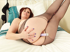 British milf Beau Diamonds toys her replete with cunny