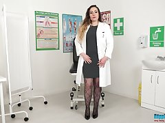 Chubby nurse in uniform Sophia Delane gets naked and shows big bosom and beamy ass