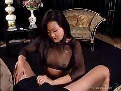 Luring Asian cougar in fishnet stockings awarding her guy a superb handjob in a reality shoot