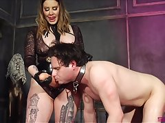 Thick Domme introduces her slave to her famous phallus