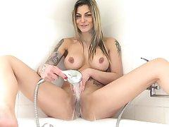 Busty model Klarisa Leone moans while fingering her pink taco