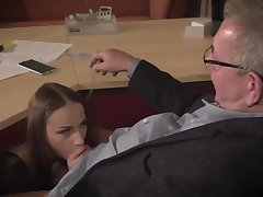 Amazing brunette with glasses is having a ffm threesome at work and enjoying it over again