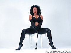 Foxy wife Danica Collins in leather enjoys pleasantry with her puss