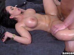 Oiled MILF Sandra spreads her legs for hardcore fucking with a stud